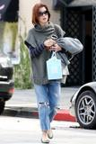 th_14683_Celebutopia-Kate_Walsh_with_ripped_jeans_in_Hollywood-11_122_135lo.JPG