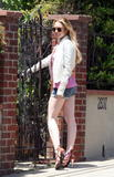 Lindsay Lohan with denim shorts shows off her legs in Malibu