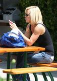 Actress Jenny McCarthy braless in black top shopping at 98% Angel in Malibu